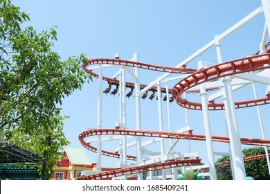 red roller coaster track in the amusement park