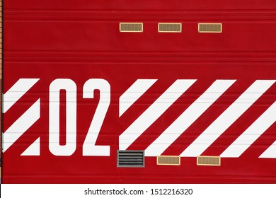 Red roller door with chevron pattern and the number two