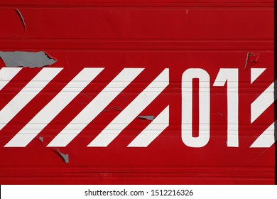 Red roller door with chevron pattern and the number one
