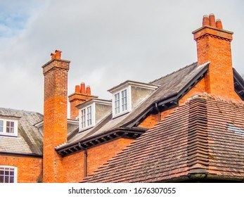 Red roof and chimneys with attic windows. Woodhall Spa. England, United Kingdom