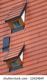 Red roof covered by tiles and two dormers