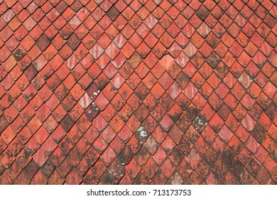 Red roofing tiles texture – An old roof background