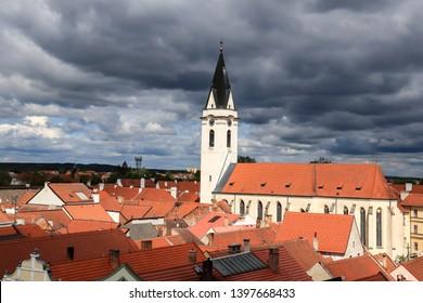 Red roofs. Church tower. Trebon city, South bohemian region, Czech Republic.