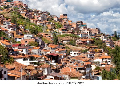 Red roofs houses on the hills in the historic capital of the Inca Empire, Cusco, Peru