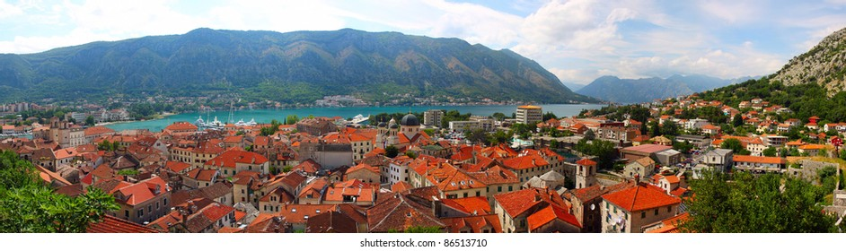 red roofs, old city on background of Kotor Bay, sunny day