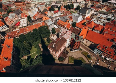 Red roofs of old Riga. Riga cityscape on a sunny summer day. City aerial view of the old town with the Dome Cathedral and the Daugava River in the city of Riga, Latvia