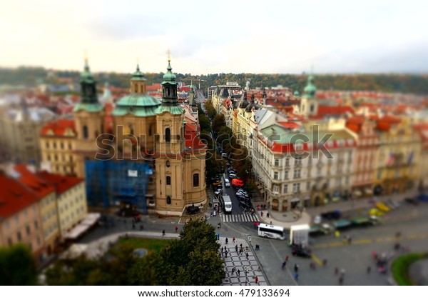 Red roofs in Prague,Czech Republic - view of the City from Above, Travel European background with tilt-shift blurred effect
