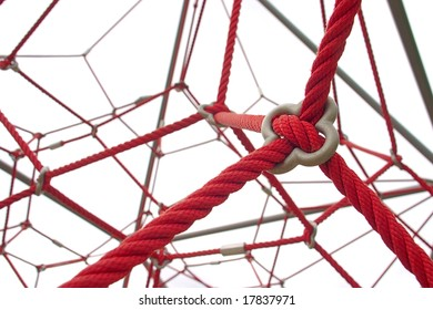 Red rope structure on white background