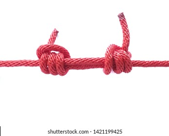 Red rope tied in various knots on a white background
