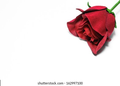 A red rose of cloth on white background as a concept of love