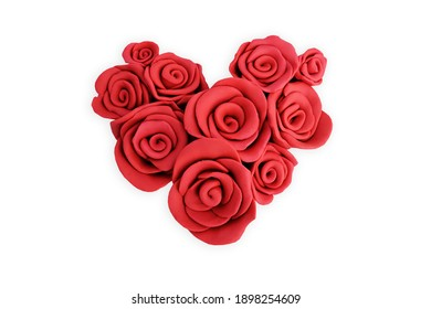 Red rose flowers made from plasticine on white background.Happy Valentine's Day. This file includes clipping path.