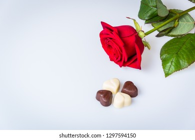 Red rose with four chocolate hearts