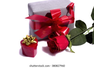 red rose and gift boxes isolated on white