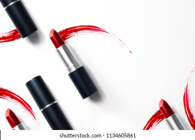 red rose lipstic cosmetic on white background