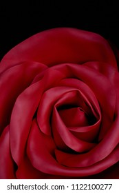 Red rose made of neoprene or artificial leather. Texture close