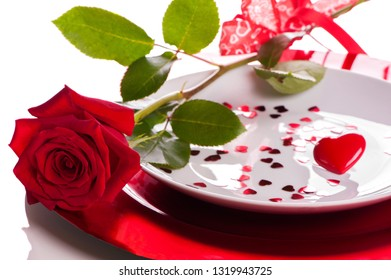 Red rose on the plate - white background - stockphoto