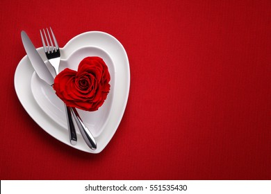 Red rose on white dish.Meal on Valentines Day