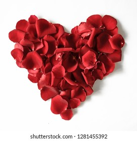 Red rose petals heart shaped on a white background