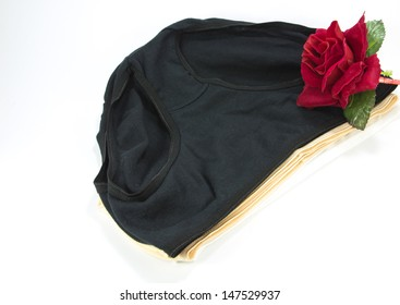 Red rose and simple women's cotton panties on white background