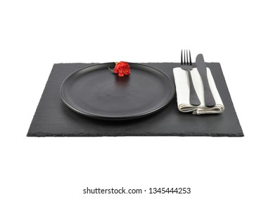 Red rose and table setting on slate isolated