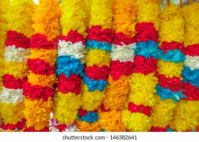 Red Rose Yellow Marigold Flower white jasmine Blue flower Garland in Market for offering in temple