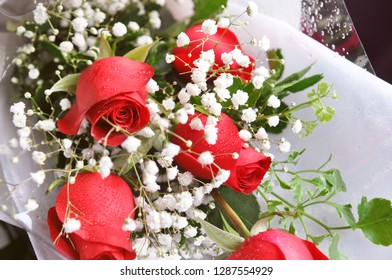 Red roses bouquet, floristry art, arranging blossom for special occasions such as wedding and valentines day