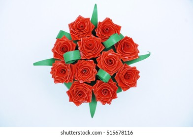 Red roses bouquet made with quiling technique