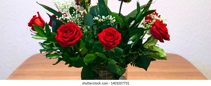 Red roses bouquet -  nature panorama or banner of beautiful flowers.