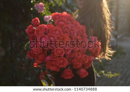 Red Roses Bouquet in Womans Hands