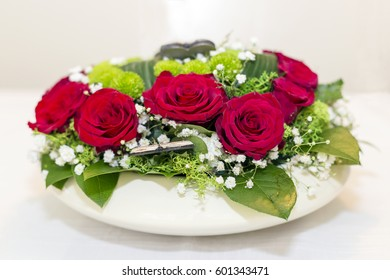 Red roses centerpiece on the table.
