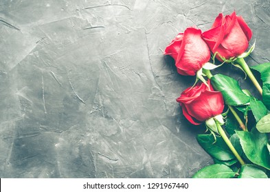 5d5e42211ced95 Red roses flowers on dark grey concrete background with place for text.  Romantic Valentines holidays