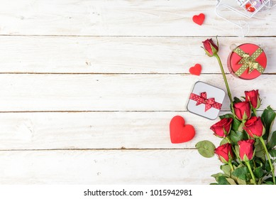 Red roses and gift box on old white wood table/Valentines day background with copy space