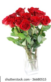 Red roses in a glass vase isolated