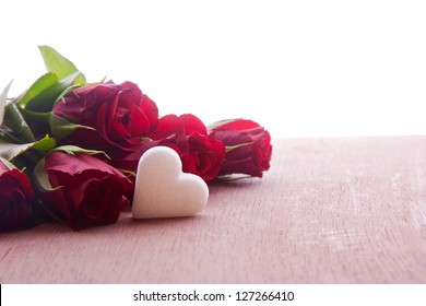 red roses with heart decoration for wedding mothers day and valentines day