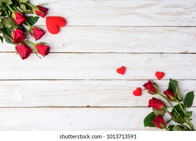 Red roses and hearts on old white wood table/Valentines day background with copy space
