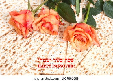 Red roses on matzot.. Jewish Passover holiday. Hebrew text - Happy Passover.
