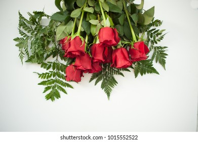 Red roses overhead view on white background