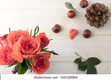 Red roses with pine cone and chestnuts