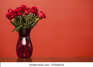 Red roses in vase on red background, Valentines Day