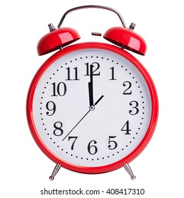 Red round alarm clock shows five minutes to two