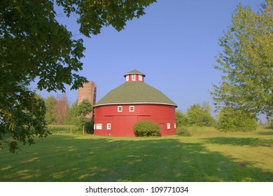A Red Round Barn in a country setting