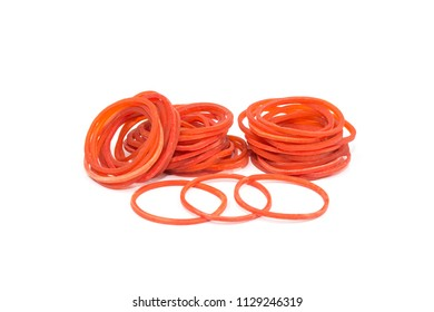 Red rubber band.Pile of rubber bands with rubberband standing out alone over white background