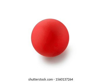 Red rubber lacrosse ball on white background