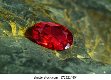 Red ruby Is an expensive gem Laying on the stone floor