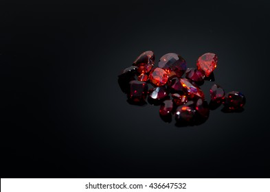 Red Ruby gem on black shine table, Color filter