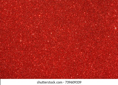 Red (ruby) glitter background. Sparkle texture. Abstract twinkle background for New Years or Christmas holiday.