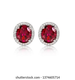 Red ruby ​​earrings, oval shape, decorated around the diamond on a white background