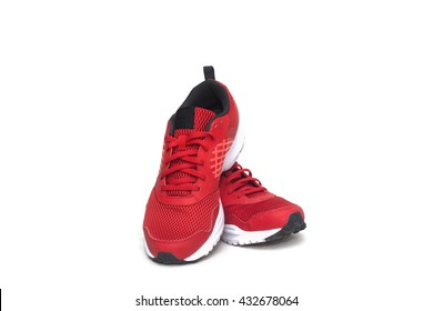 Red running shoes isolated on white background