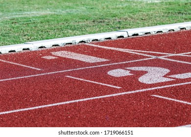 Red running sport track background and texture. Sport running track concept.