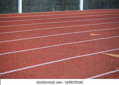 Red running track with all weather surface